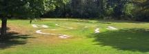 Ngừng ở một trạm nghỉ chân, biên giới NJ và PA thấy trên sân cỏ có hình bản đồ NJ